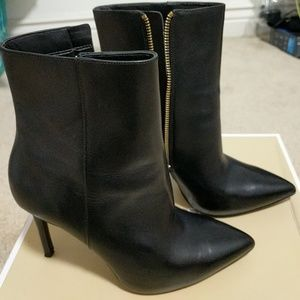 A pair of Michael Kors boots/booties
